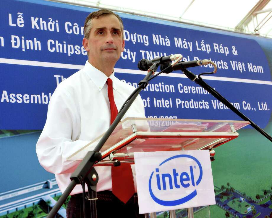 FILE - In this  Wednesday, March 28, 2007, file photo, Intel Corp. Vice President and General Manager of Assembly and Test Brian Krzanich makes his speech at the start of construction ceremony of the Assembly and Test Facility of Intel's chipset products at Saigon High Tech Park, Ho Chi Minh city, South Vietnam.  Intel said Thursday, May 2, 2013,  that it has chosen Krzanich, as its new CEO to steer the world's largest chipmaker in a world where PC sales are cratering while smartphones and tablets thrive.  (AP Photo/Le Quang Nhat) Photo: LE QUANG NHAT