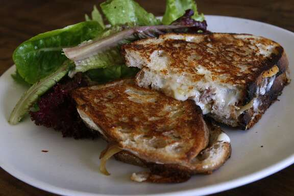 A grilled cheese sandwich is served with mixed organic greens at Osteria Stellina in Point Reyes Station, Calif., on Friday, June 11, 2010. Stellina's chef/owner Christian Caiazzo also owns and operates the coffee bar at Toby's Feed Barn across the street.