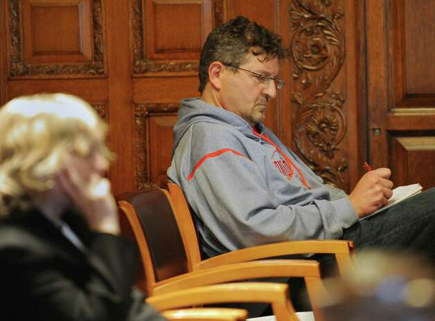 John Aretakis listens from the back of the court room as attorney Cheryl Coleman contends to judges on the New York Court of Appeals that Christopher Oathout received an ineffective defense at trial from him on Thursday, March 21, 2013 in Albany, N.Y. Christopher Oathout is a former cabdriver found guilty of strangling and stabbing 69-year-old Robert Taylor in 2006. (Lori Van Buren / Times Union) Photo: Lori Van Buren / 00021678A