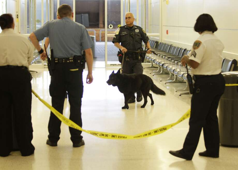 Police are on the scene at shooting in Terminal B at Bush Intercontinental Airport, Thursday, May 2, 2013. Photo: Melissa Phillip