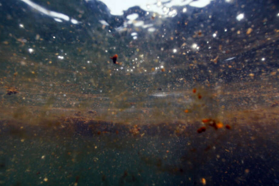 Patches of oil from the Deepwater Horizon spill are seen underwater in the Gulf of Mexico, south of Venice, La., on Monday, June 7, 2010.