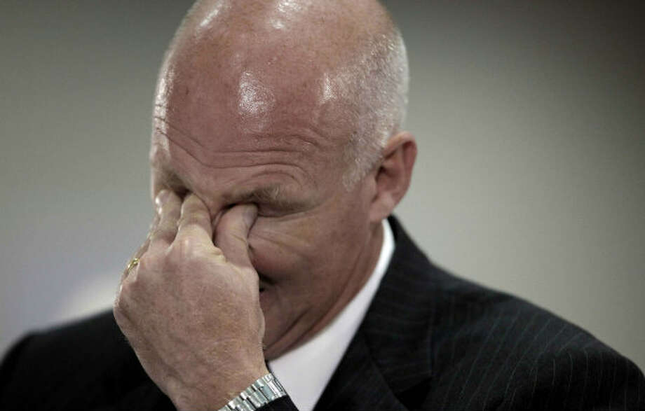 BP Senior Vice President Kent Wells rubs his eyes while testifying during the Deepwater Horizon joint investigation hearings Aug. 26, 2010. The hearings were held by the U.S. Coast Guard and the Interior Department's Bureau of Ocean Management, Regulation and Enforcement in Houston .