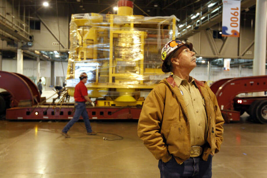 T&T Crane and Rigging employees prepare to move the FMC Technologies 118,000-pound subsea tree into the Reliant Center for the Offshore Technology Conference in Houston. OTC, running May 6 to 9, attracts more than 80,000 attendees from more than 110 countries. Subsea trees are structures that control the flow of oil and gas to and from the subsea well.