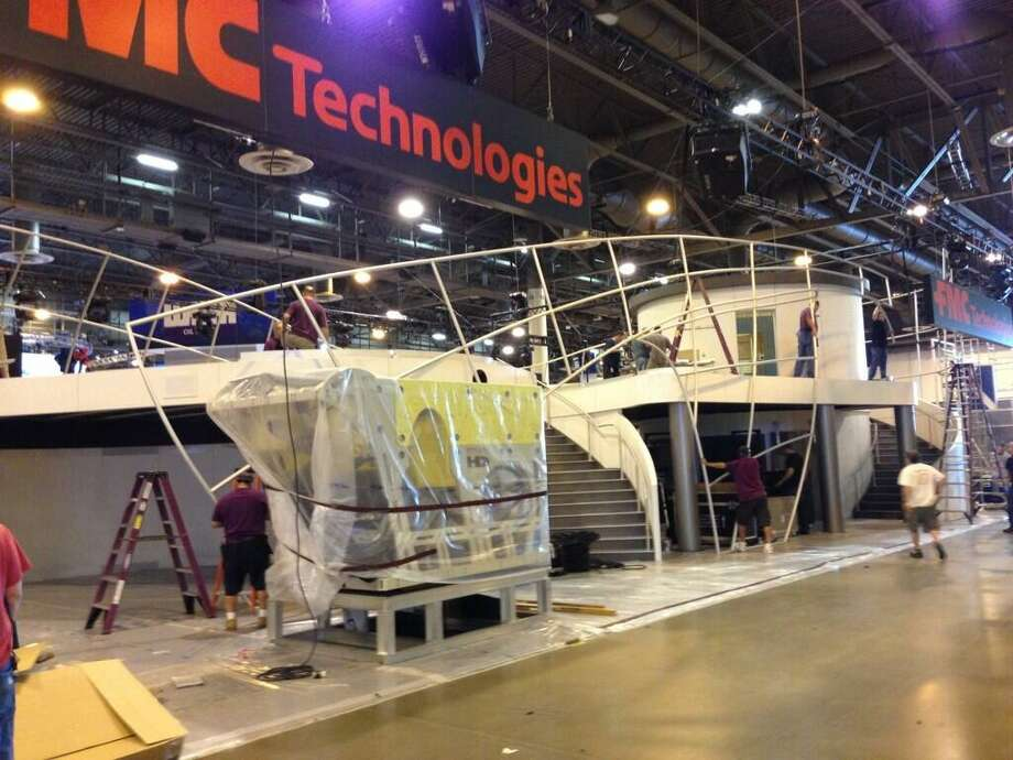 @vette4tk via Twitter: @FMC_Tech erecting a 22' tall canvas for #OTCHOUSTON ....the one and only at the show. See more one-of-a-kind 1941