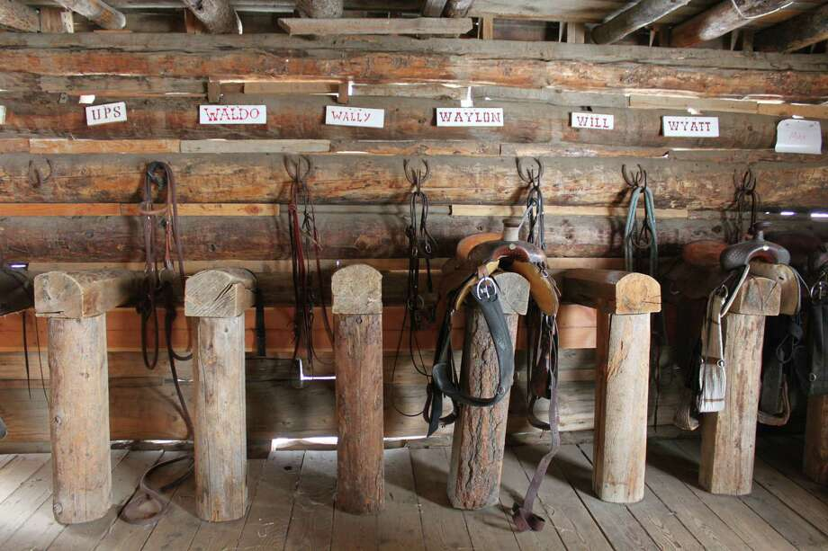 Saddles and equipment for the ranch's 95 horses line the barn walls at the Home Ranch. Photo: Courtesy Photo