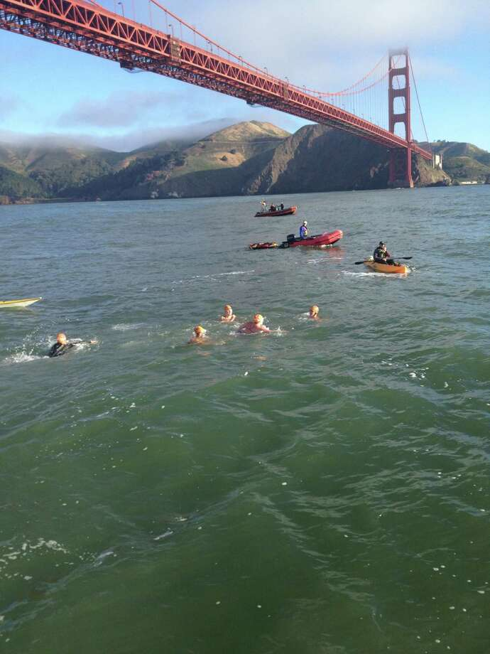 Swimmers prepare to start the 2102 Bridge to Bridge 10K Swim. The 6.2-mile swim in the San Francisco Bay is limited to 30 participants willing to brave strong currents, cold water, marine life and more as they swim from the Golden Gate Bridge to the Bay Bridge. In 2013 two San Antonio women, Mary Kay Cooper and Sheryl Crump plan to participate. Photo: Waterworldswim.com Media