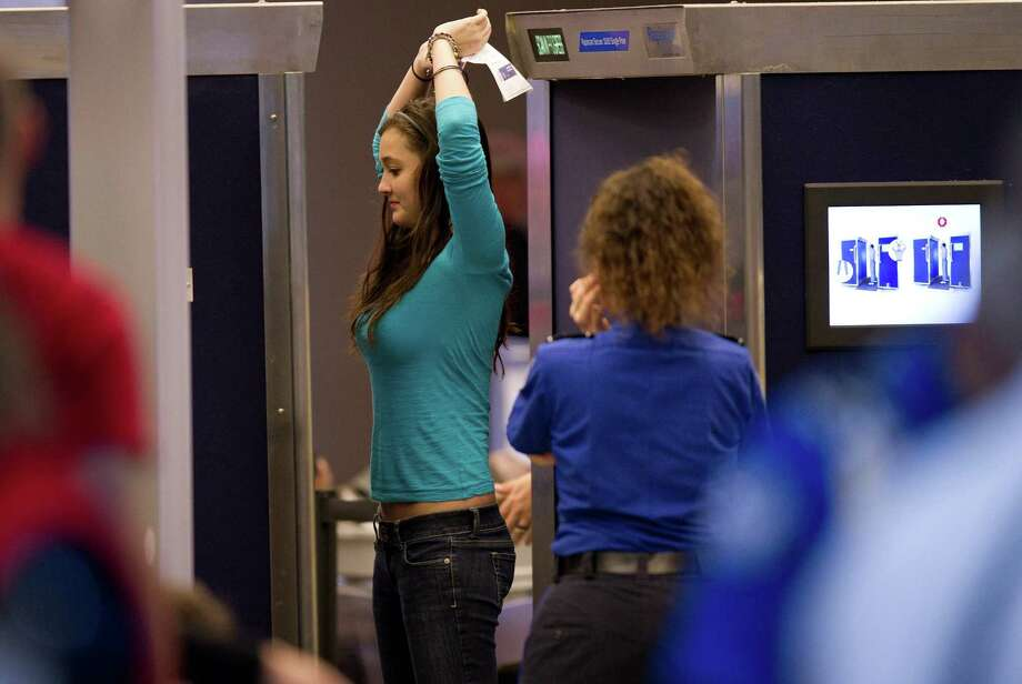 TSA officers will still thoroughly search us at airports. Photo: Jeff Swensen, Multiple / 2010 Getty Images