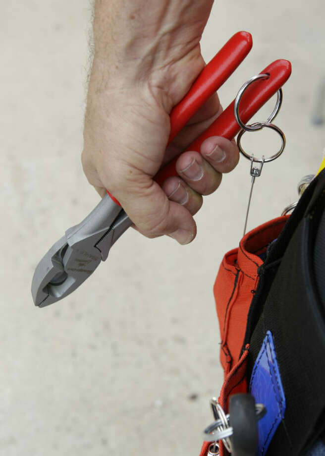 A pair of linesmen pliers part of a tethered tools system called Snap-on Tools at Height are shown at the Snap-on mobile advance technology lab during a demonstration at NOV Wilson Distribution Center, 12000 West Little York Road, Thursday, April 25, 2013, in Houston. Snap-on Industrial is making a major push into the oil and natural gas markets by introducing several new tools and equipment to these industries. Snap-on is launching these new tools in a national tour. NOV Wilson is a large distributor of products aimed at the maintenance activities for the oil, drilling and natural gas industries.
