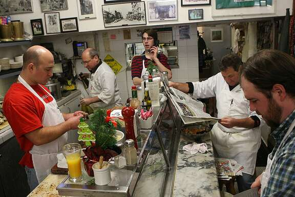 Clockwise--Kevin Sancimino, Jimmy Sancimino, Brian Dwyer, Tom Sancimiino, and Erik Wideman doing their morning preparations at Swan Oyster Depot in San Francisco, Calif.,  on Friday, December 2, 2011.