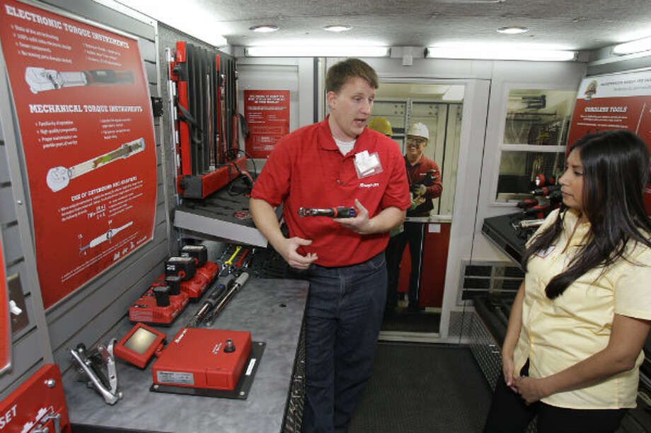 Joshua Ladwig, area sales manager for Snap-on, talks to Kim Gonzales, a NOV inside sales supervisor, about electronic torque instruments inside the Snap-on mobile advance technology lab during a demonstration at NOV Wilson Distribution Center, 12000 West Little York Road, Thursday, April 25, 2013, in Houston. Snap-on Industrial is making a major push into the oil and natural gas markets by introducing several new tools and equipment to these industries. Snap-on is launching these new tools in a national tour. NOV Wilson is a large distributor of products aimed at the maintenance activities for the oil, drilling and natural gas industries.