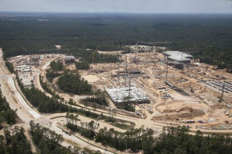 Summer 2012: These aerial photographs show the progress on Exxon Mobil's huge corporate campus south of The Woodlands. The 385-acre development is west of Interstate 45 near the Hardy Toll Road. It's being built to house at least 10,000 people and completion is schedueld for 2015 . An early estimate pegged the construction cost at more than $1.2 billion.