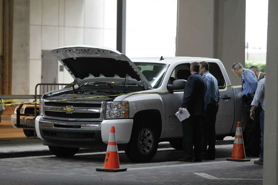 Police investigate a truck park outside terminal B after shooting in terminal B at I H A Thursday, May 2, 2013. Photo: Melissa Phillip