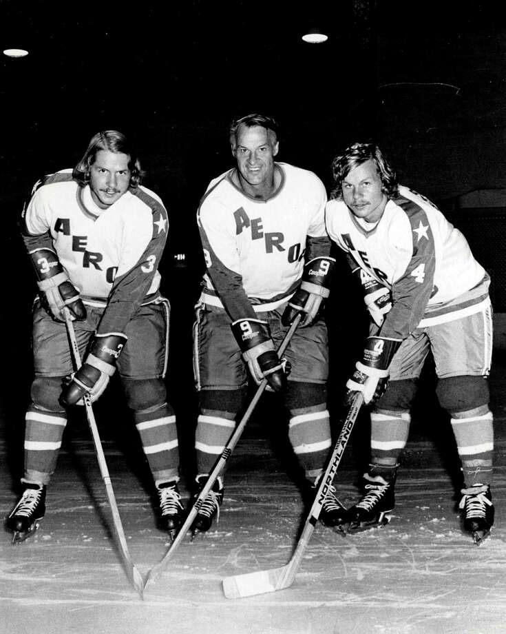 "In an Aug. 3, 1973 file photo, former Detroit Red Wings great Gordie Howe, center, is flanked by sons Marty, left, and Mark as they try their new Houston Aeros uniforms in St. Clair Shores, Mich. A made-for-TV movie, ""Mr. Hockey: The Gordie Howe Story,"" focuses on the season the Hall of Famer teamed up with his sons in Houston. The U.S. premiere of the film is Saturday, May 4, 2013. (AP Photo/The Macomb Daily, David Posavetz, FILE) Photo: David Posavetz, Associated Press / The Macomb Daily"