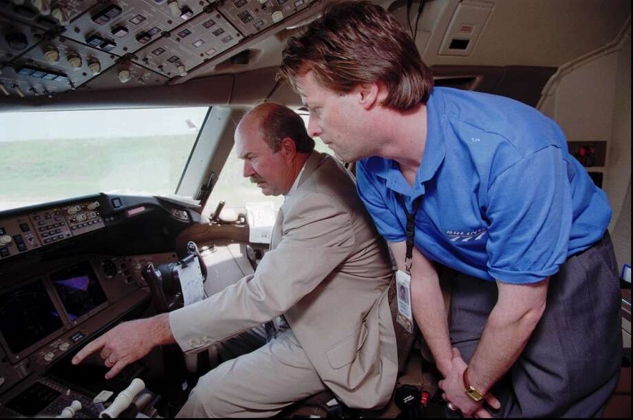 Boeing flight analyst Vince Rydell, right, shows off the flight deck of a new Boeing 777-200 to Delta International Flight Operations Director Terry Cusick outside the Delta hanger at Hartsfield Atlanta International Airport in Atlanta Friday, May 17, 1996. Photo: JOHN BAZEMORE, Associated Press / AP