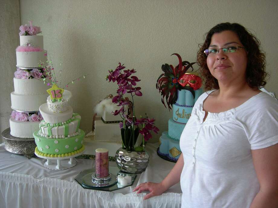 Models of wedding and quinceañera cakes are on display at Beatriz Gonzalez's new shop, Bea's Sweet Cakes & More.
