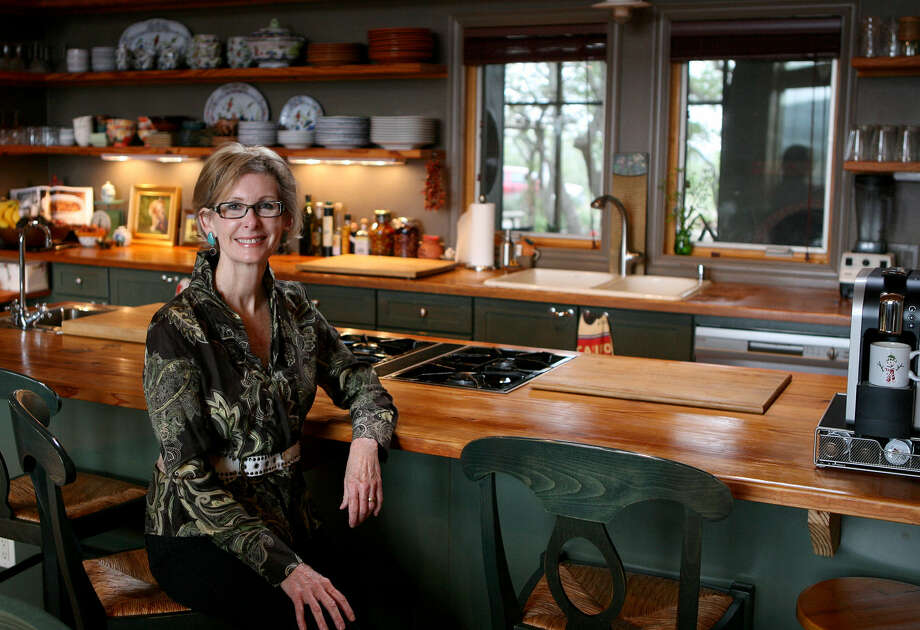 "Rollie Blackwell-Devlin chose rustic but elegant materials for the kitchen at Stony Ridge Ranch. ""I wanted to keep the integrity of being in the country."" Photo: Photos By Cynthia Esparza / For The Express-News"
