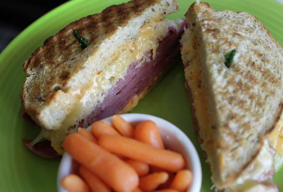 """1. He eats local instead of """"household names""""When he's in a crunch for a quick, healthy munch he goes to """"hole-in-the-wall"""" sandwich shops for a """"fresh and healthy"""" meal. Photo: San Antonio Express-News / ©2013 San Antonio Express-News"""