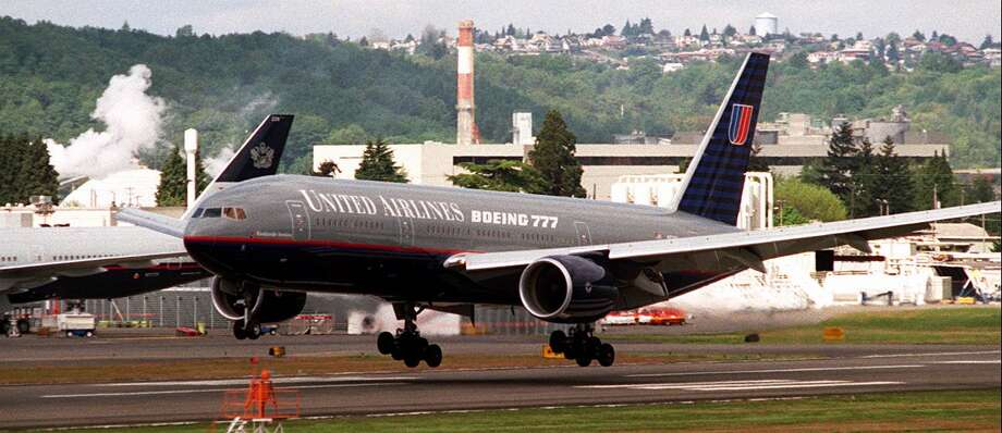 A Boeing 777 touches down at Boeing Field, in Seattle, on April 30, 1995, after 27-day around-the-world tour. Photo: Scott Eklund, Seattlepi.com File