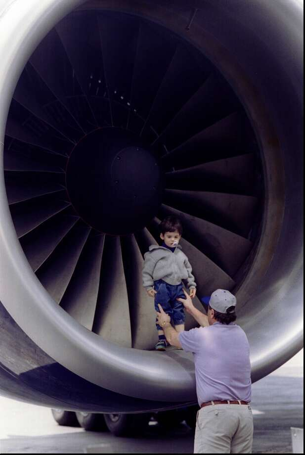 Chief Purser Jeff Nouwens hoists 29-month-old son Alex onto 