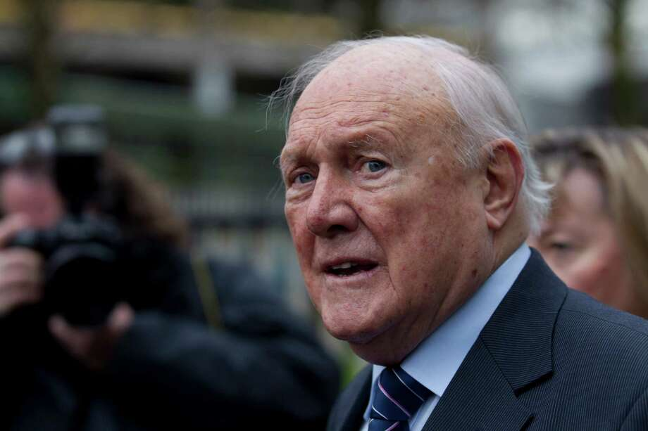 FILE - In this Thursday Feb. 7, 2013 file photo, former BBC broadcaster presenter Stuart Hall makes a statement to the media after appearing in court in Preston, England. BBC broadcaster Stuart Hall has pleaded guilty to multiple assaults on young girls. Prosecutors said Thursday May 2, 2013 that the 83-year-old sports broadcaster has pleaded guilty to 14 indecent assaults. (AP Photo/Jon Super, File) Photo: Jon Super, STR / AP