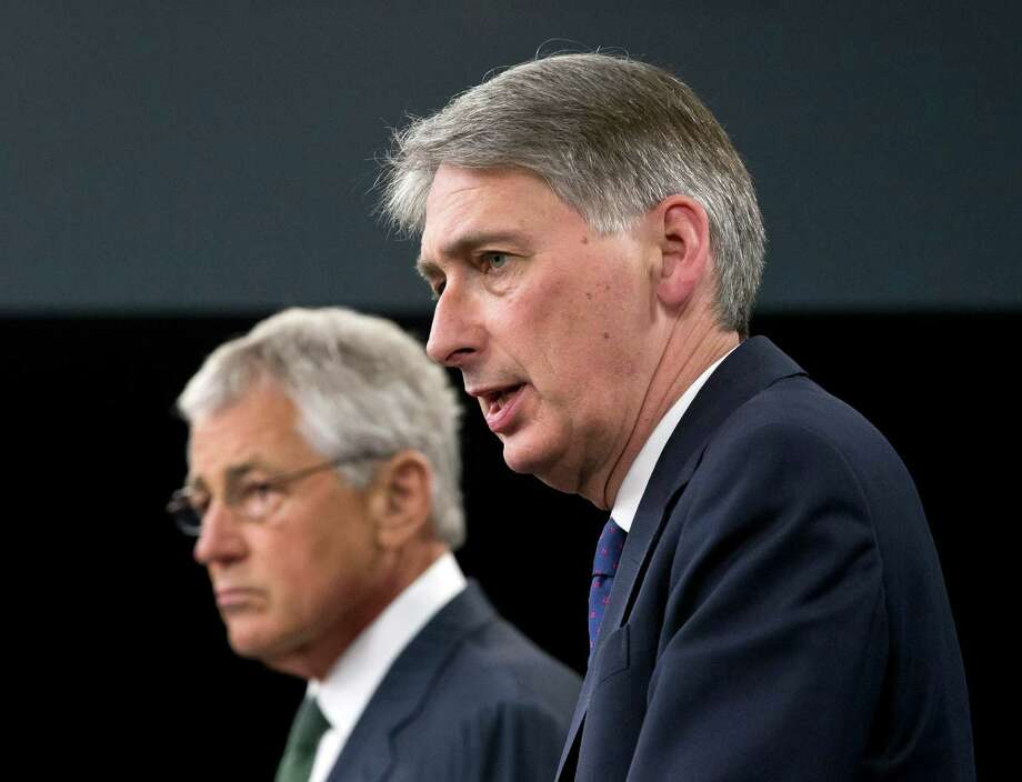 Defense Secretary Chuck Hagel and British Defense Secretary Philip Hammond participate in a  joint news conference at the Pentagon, Thursday, May 2, 2013, where the talked about Syria.  (AP Photo/J. Scott Applewhite) Photo: J. Scott Applewhite, STF / AP