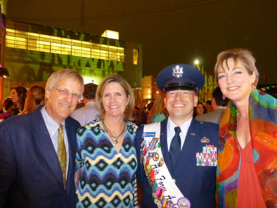 Mike and Harriet Fanning (from left) enjoy The German Club's Fiesta German party at the San Antonio Museum of Art with Air Force Capt. Aaron Eggers, a Fiesta Military Ambassador, and Karen Harrison.