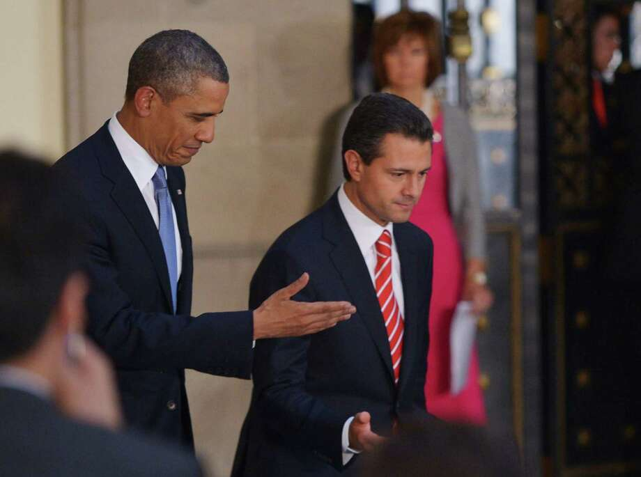 Mexican President Enrique Pena Nieto and US President Barack Obama arrive for a joint press conference following a bilateral meeting on May 2, 2013 at the Palacio Nacional in Mexico City. Obama landed in Mexico on Thursday at the start of a three-day trip that will also take him to Costa Rica, with trade, US immigration reform and the drug war high on the agenda. AFP PHOTO/Mandel NGANMANDEL NGAN/AFP/Getty Images Photo: MANDEL NGAN, AFP/Getty Images / AFP