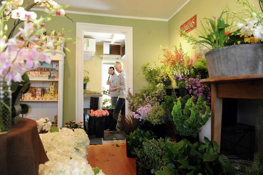 Alex Cordero, of Bridgport, and Liv Barker, of Wilton, getting ready for Mother's Day, at  Fleurish-the Flower Shop in an old farmhouse in Greenwich, Thursday, May 2, 2013. Photo: Helen Neafsey / Greenwich Time