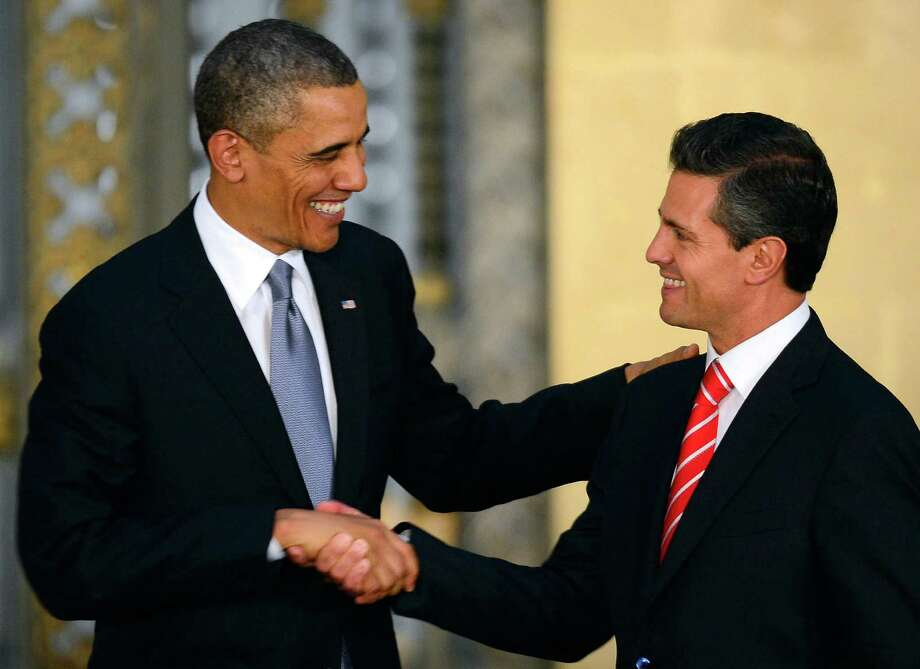 US President Barack Obama (L) and Mexican President Enrique Pena Nieto shake hands during a joint press conference at the National Palace in Mexico City on May 2, 2013. Obama landed in Mexico on Thursday at the start of a three-day trip that will also take him to Costa Rica, with trade, US immigration reform and the drug war high on the agenda.  AFP PHOTO/Alfredo ESTRELLAALFREDO ESTRELLA/AFP/Getty Images Photo: ALFREDO ESTRELLA, AFP/Getty Images / AFP