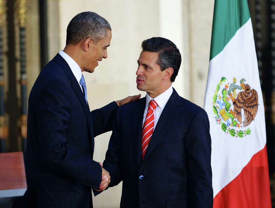 US President Barack Obama (L) shakes hands with Mexican President Enrique Pena Nieto during a joint press conference at the National Palace in Mexico City on May 2, 2013. Obama landed in Mexico on Thursday at the start of a three-day trip that will also take him to Costa Rica, with trade, US immigration reform and the drug war high on the agenda.  AFP PHOTO/Mandel NGANMANDEL NGAN/AFP/Getty Images Photo: MANDEL NGAN, AFP/Getty Images / AFP