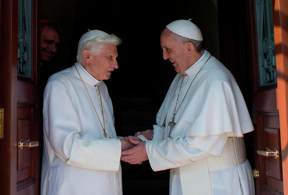 Pope Emeritus Benedict XVI, left, greeted by his successor Thursday, will share quarters behind St. Peter's Basilica with his secretary, Georg Gaenswein, rear. Photo: HOPD / Osservatore Romano