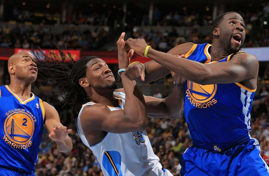 Draymond Green (23) of the Golden State Warriors is called for a flagrant foul type one as he collides with Kenneth Faried (35) of the Denver Nuggets during Game 5 of the Western Conference Quarterfinals on April 30, 2013 in Denver. The Nuggets defeated the Warriors 107-100.