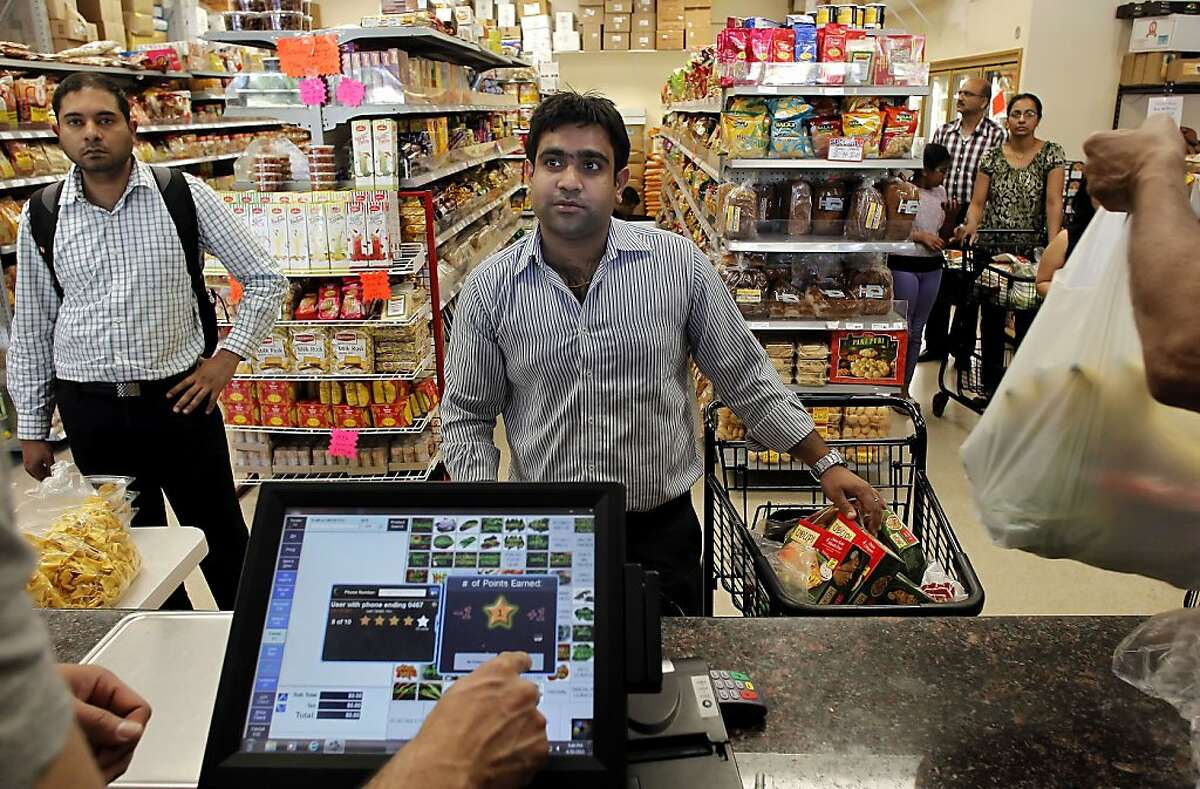 Sri Gutta, (left) and Sachin Khatter checking out after shopping the Patel Grocery in San Ramon, Calif. on Tues. April 30, 2013. The owners said the reason they opened the grocery store a year and a half ago was to cater to the immigrant population in the San Ramon Valley. The exploding influx of Asian immigrants into California in recent years has created a new phenomenon up and down the state, the Asian suburb.