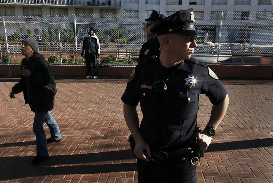 Officers Mark Hodge and James Funk (front) keep watch on Market Street in January. More people are having their phones stolen on the streets. Photo: Michael Macor, The Chronicle