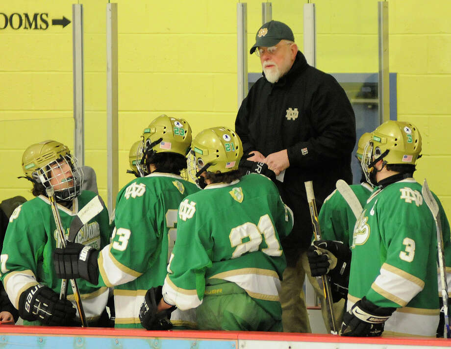 Notre Dame - West Haven coach Bill Gerosa confers with his players as Notre Dame - West Haven challenges Trinity Catholic High School at Terry Conners Rink in Stamford, CT on Tuesday December 28, 2010. Photo: Shelley Cryan, ST / Shelley Cryan freelance; Stamford Advocate freelance