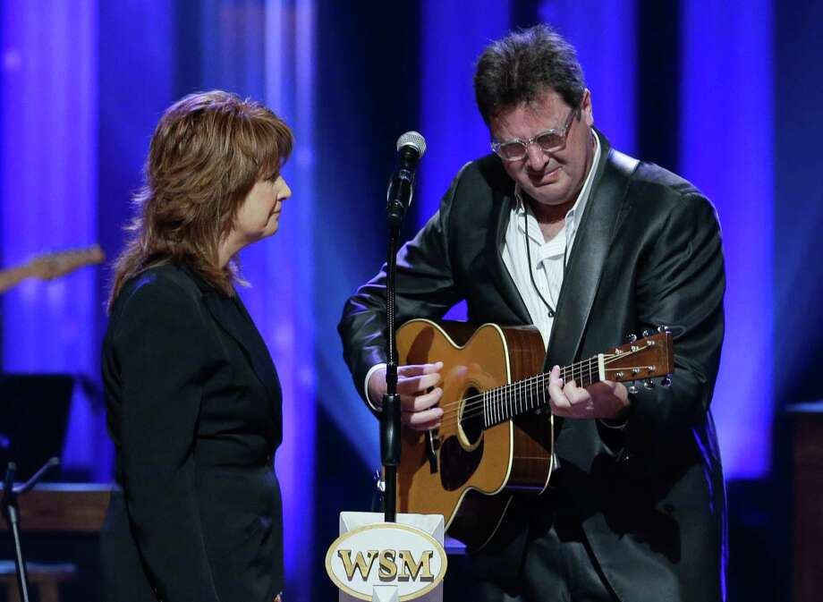 Vince Gill cries as he performs with Patty Loveless during the funeral for country music star George Jones in the Grand Ole Opry House on Thursday. Their performance was an emotional highlight of the service. Photo: Mark Humphrey, POOL / AP POOL