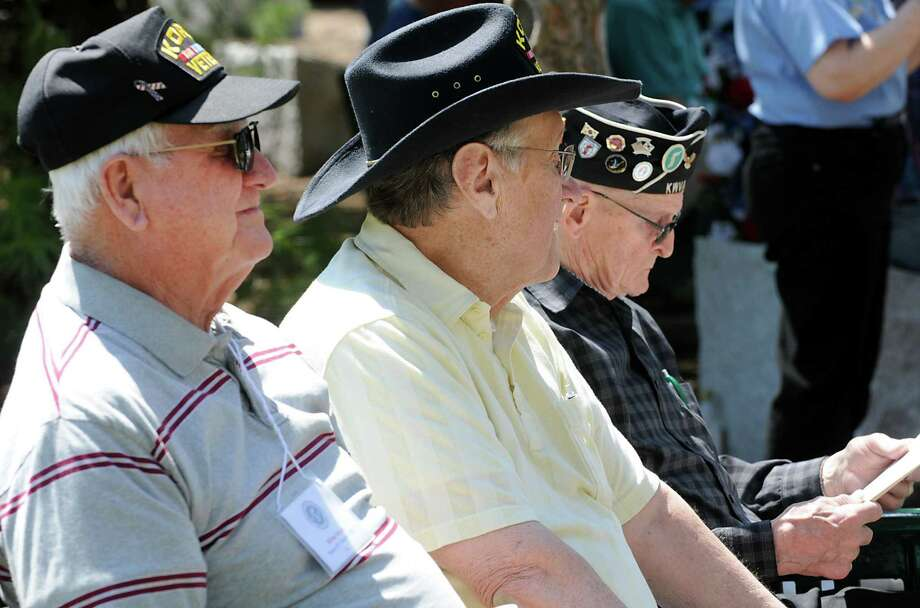 From left, veterans William Boyce of Hicksville, William Bump of Rochester and Lyell Brown of Aurbun sit on a bench during a Korean War Veterans Association memorial at Saratoga National Cemetery on Thursday, May 2, 2013 in Schuylerville, N.Y. (Lori Van Buren / Times Union) Photo: Lori Van Buren / 10022164A