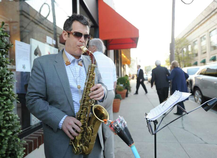Saxophonist Matt Criscuolo of Wilton performs during the opening night of Art to the Avenue, Thursday, May 2, 2013. More than 150 artists will display artworks at local stores and businesses through May 27. All art is for sale. A portion of sales is tax deductible and benefits the Greenwich Arts Council. For a map of artists and their locations, visit www.greenwich arts.org. Photo: Bob Luckey / Greenwich Time