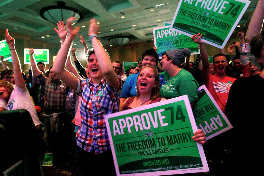 Supporters cheer at an election watch party for proponents of Referendum 74, which would uphold the state's new same-sex marriage law, Tuesday, Nov. 6, 2012, in Seattle. Photo: Elaine Thompson, AP / AP