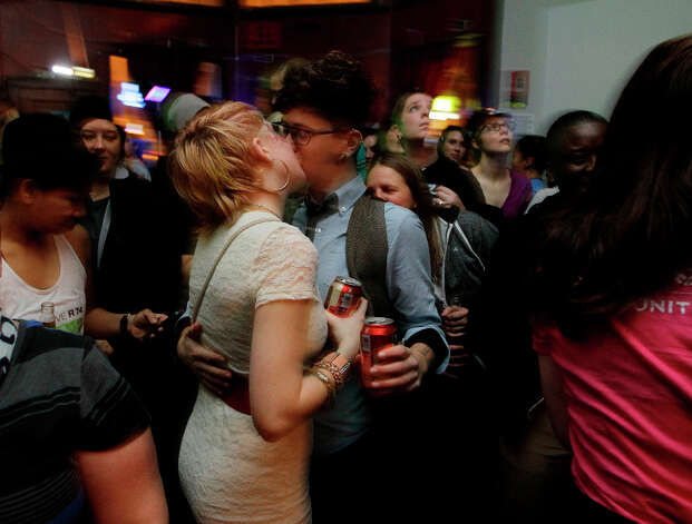 Two supporters of Washington state's Referendum 74 kiss as they celebrate early election returns, Tuesday, Nov. 6, 2012, in Seattle's Capitol Hill neighborhood. Referendum 74 would legalize same-sex marriage. (AP Photo/Ted S. Warren) Photo: Ted S. Warren, ASSOCIATED PRESS / AP2012