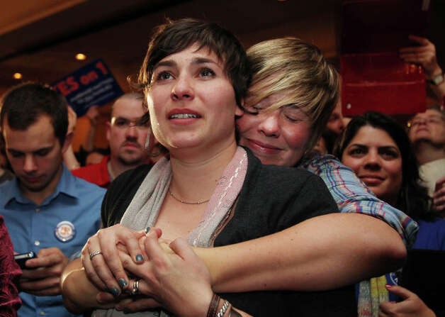 Lauren Snead, right, hugs her partner Katy Jayne, left, as they celebrate the legalization of same-sex marriage Tuesday Nov. 6, 2012  in Portland, Maine. Snead and Jayne plan to marry in the near future. Photo: Joel Page, AP / FR23211 AP