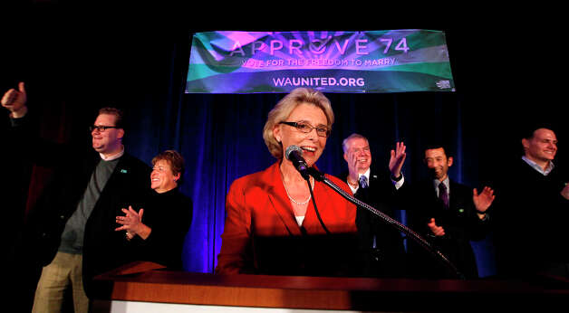 Gov. Chris Gregoire, center, speaks as other elected officials stand behind at an election watch party for proponents of Referendum 74, which would uphold the state's new same-sex marriage law, Tuesday, Nov. 6, 2012, in Seattle. Photo: Elaine Thompson, AP / AP