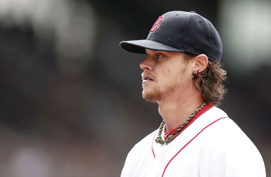 Boston Red Sox starting pitcher Clay Buchholz walks off the mound during the sixth inning of a baseball game against the Tampa Bay Rays at Fenway Park in Boston Sunday, April 14, 2013. (AP Photo/Winslow Townson) Photo: Winslow Townson, FRE / FR170221 AP