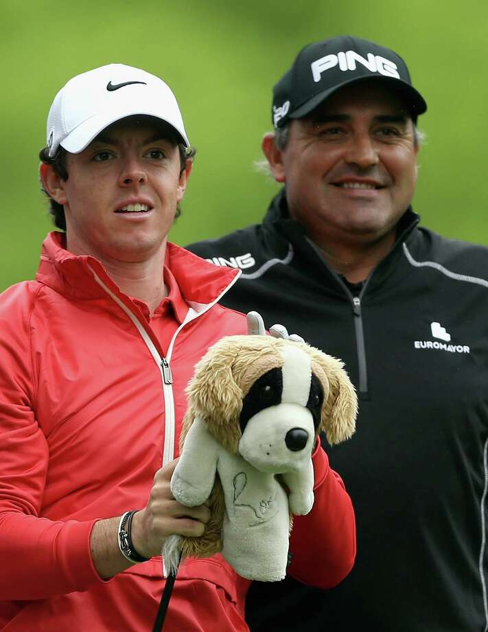 CHARLOTTE, NC - MAY 02:  Rory McIlroy of Northern Ireland and Angel Cabrera of Argentina wait to hit on the 11th tee during the first round of the Wells Fargo Championship at Quail Hollow Club on May 2, 2013 in Charlotte, North Carolina.  (Photo by Streeter Lecka/Getty Images) Photo: Streeter Lecka