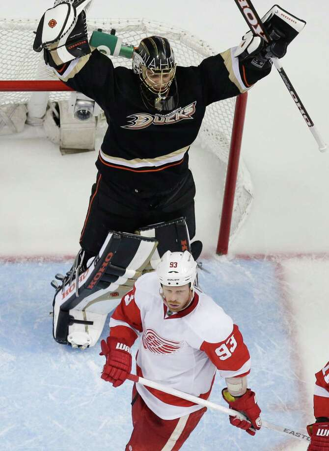 Anaheim Ducks goalie Jonas Hiller, top, celebrates over Detroit Red Wings left wing Johan Franzen during the second period in Game 1 of their first-round NHL hockey Stanley Cup playoff series in Anaheim, Calif., Tuesday, April 30, 2013. (AP Photo/Chris Carlson) Photo: Chris Carlson / AP