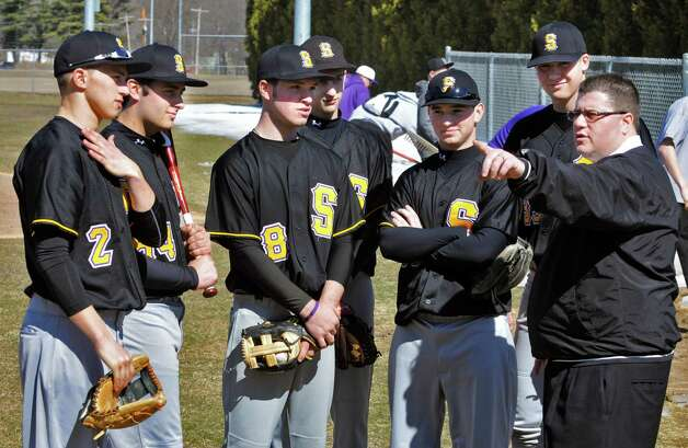 Spa Catholic baseball coach Phonsey Lambert, at right, with players from left, Dylan Anderson, Chris Pescetti, Dale Long, Brad Scammell, Billy McDonough, and Jack Keller at the Geyser Road Ball Field in Saratoga Springs Thursday afternoon April 7, 2011.   (John Carl D'Annibale / Times Union) Photo: John Carl D'Annibale / 00012686A