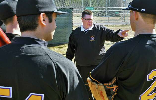 Spa Catholic baseball coach Phonsey Lambert, center, with some of his players at the Geyser Road Ball Field in Saratoga Springs Thursday afternoon April 7, 2011.   (John Carl D'Annibale / Times Union) Photo: John Carl D'Annibale / 00012686A