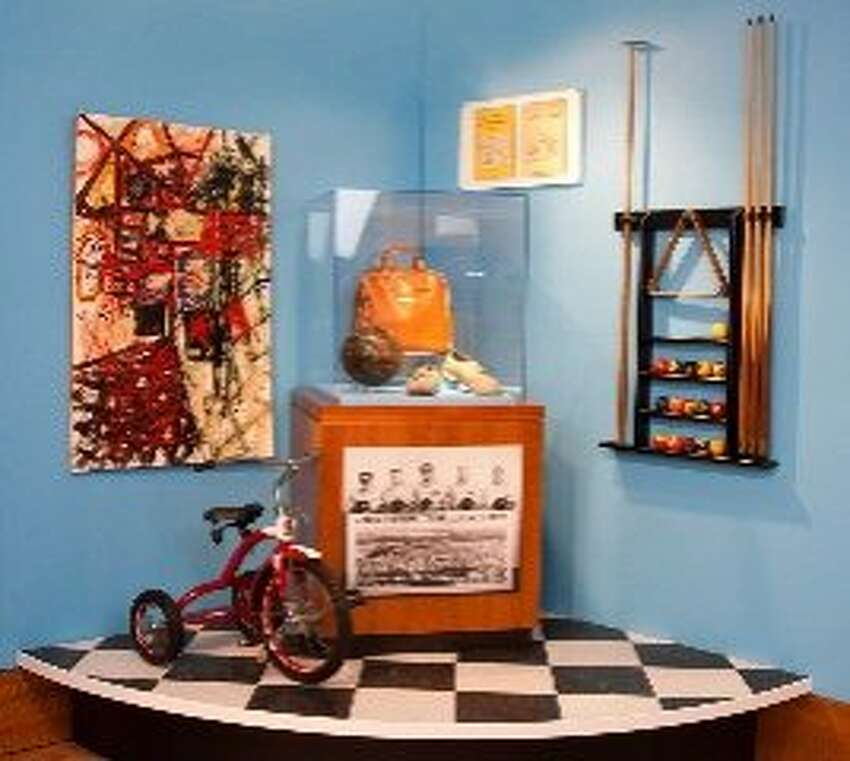 The exhibition includes Charles Schulz's bowling equipment, pool cues and other personal belongings.