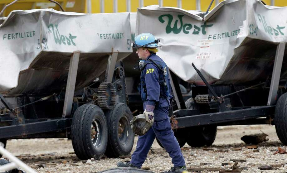 An investigator carries a piece of debris at the scene of the destroyed fertilizer plant in West on Thursday. Investigators face a slew of challenges in figuring out what caused the explosion at the fertilizer plant that killed 14 people and damaged buildings. Photo: LM Otero, POOL / AP POOL