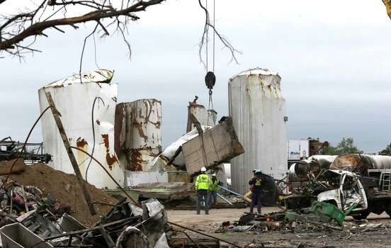 Investigators move and look through the debris of the destroyed fertilizer plant in West, Texas, Thursday, May 2, 2013. Investigators face a slew of challenges in figuring out what caused the explosion at the fertilizer plant that killed 14 people and destroyed part of the small Texas town. (AP Photo/LM Otero, Pool) Photo: LM Otero, POOL / AP POOL